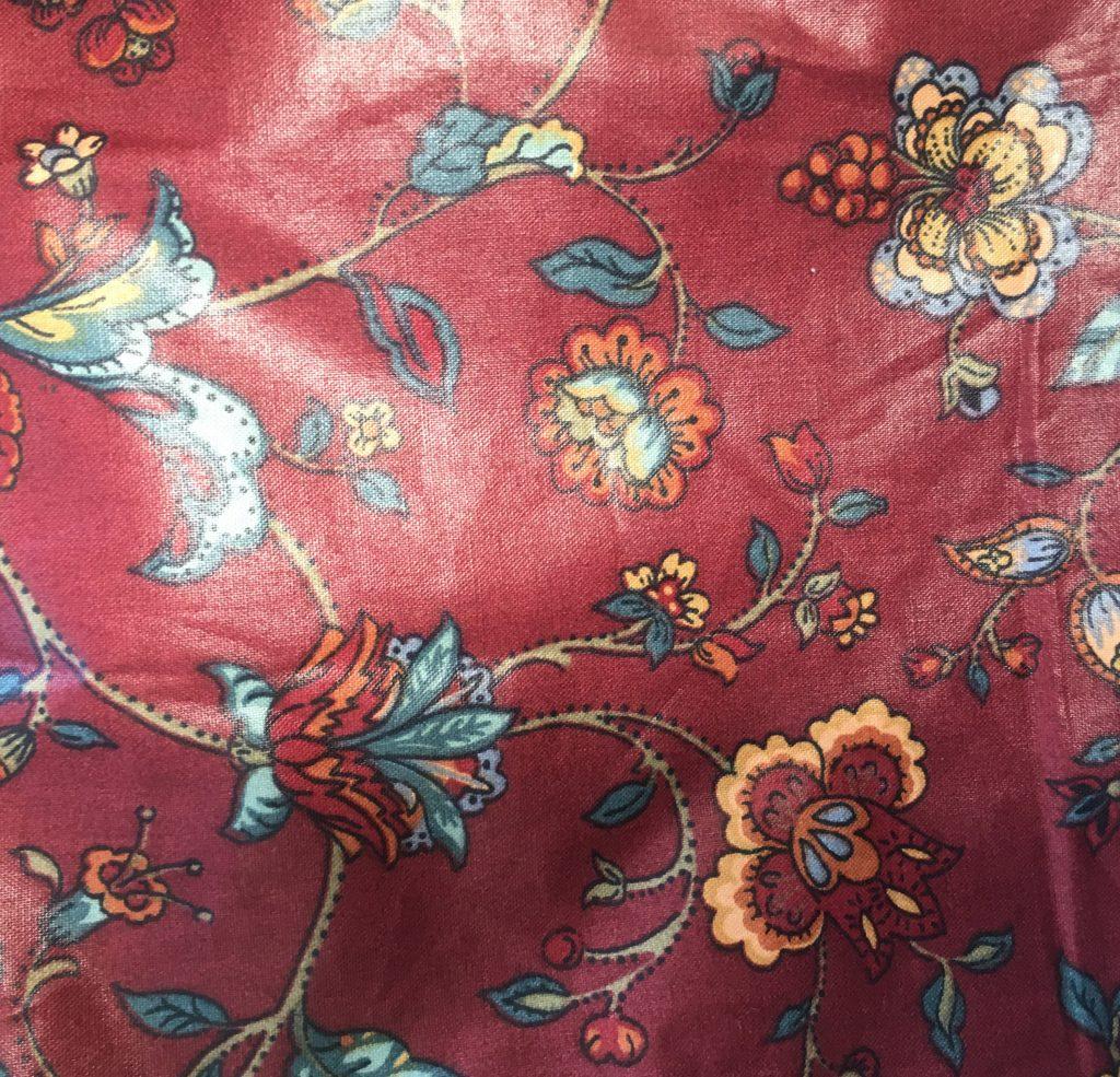 Tessuto a fiori rosso in cotone cerato