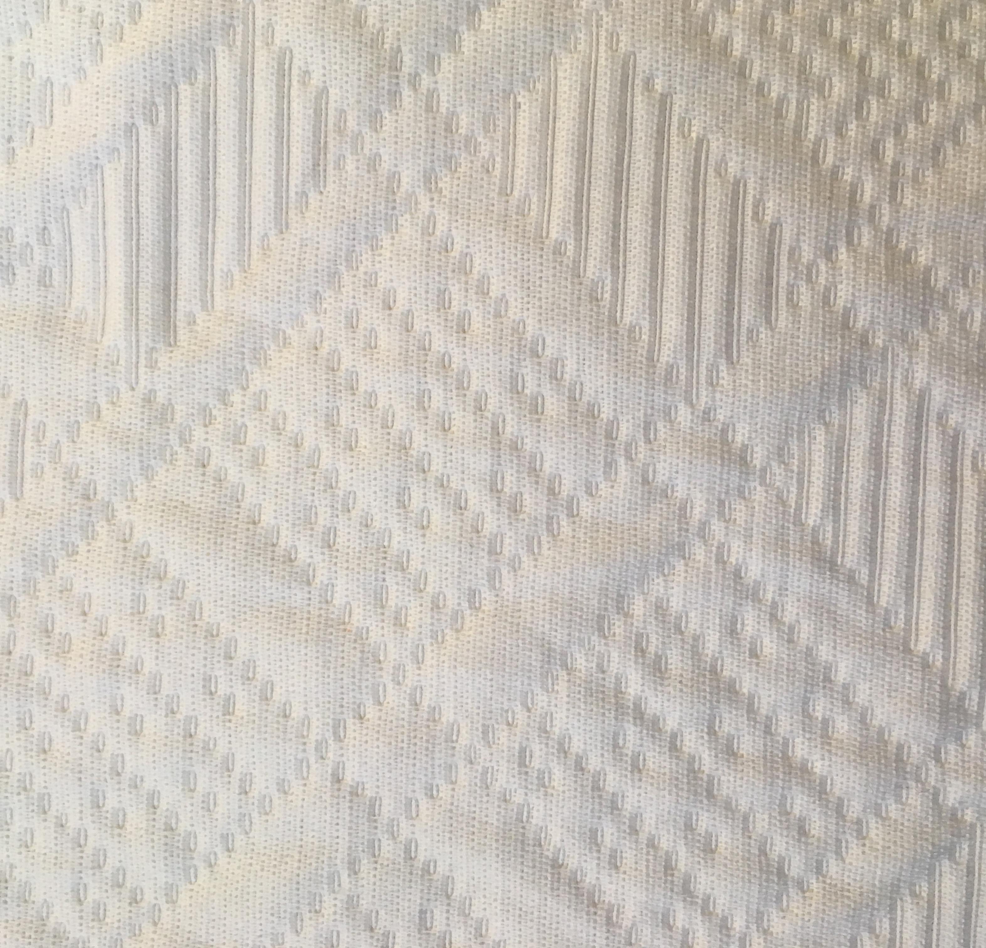 tessuto bianco ricamato